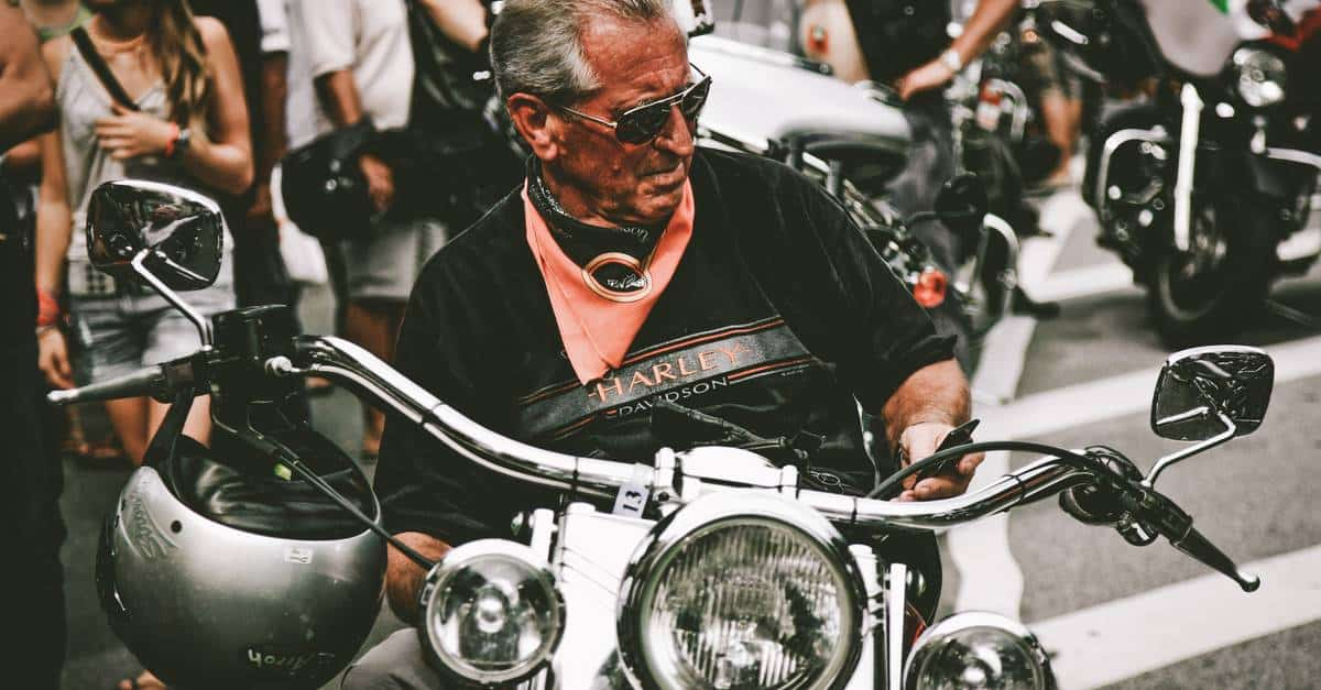 A man sitting on a motorcycle