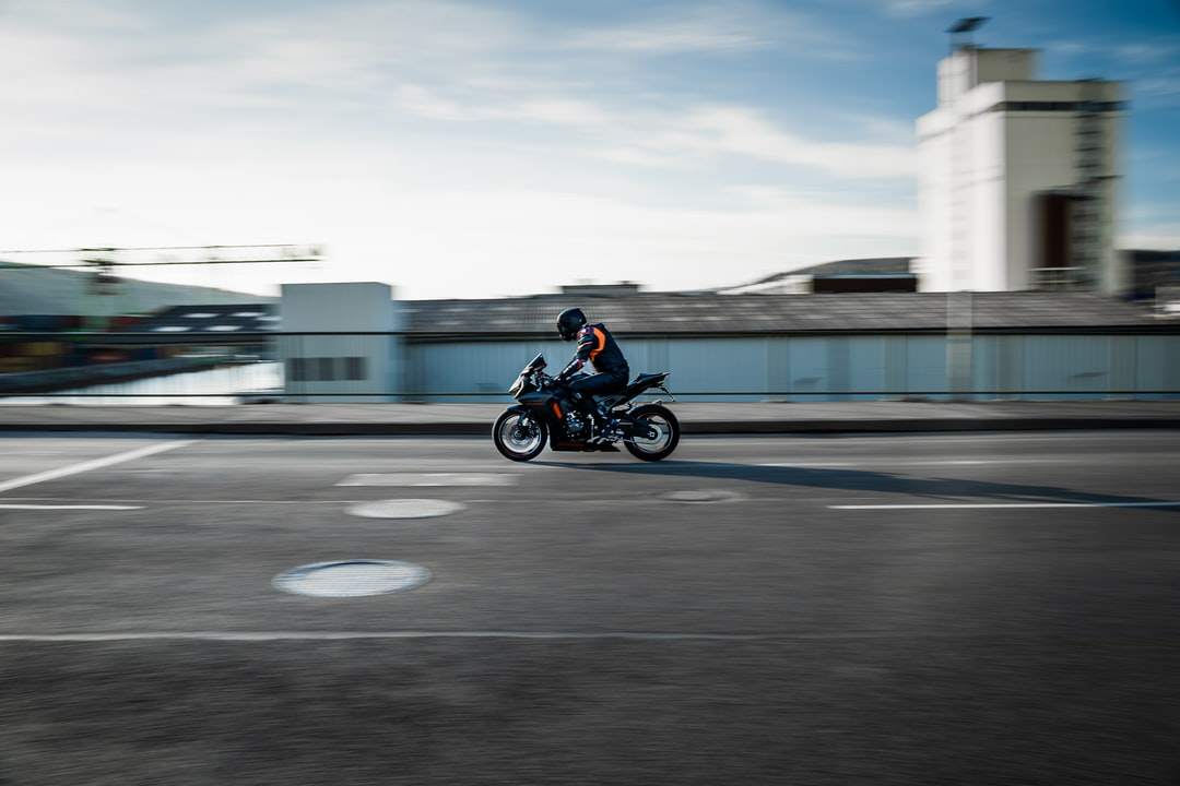 A man riding a motorcycle down the road