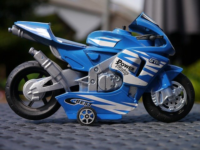 A blue motorcycle parked on the side of a road